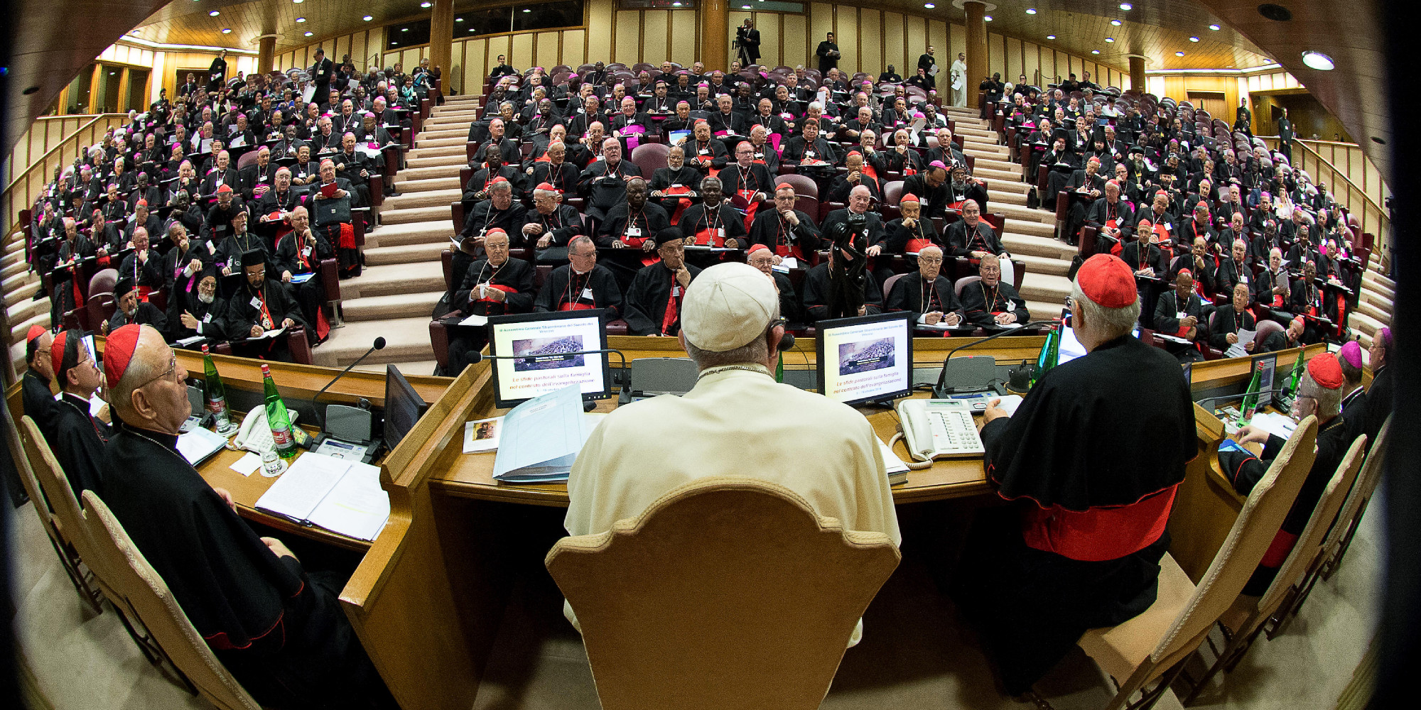 "A handout picture released by the Vatican press office show Pope Francis (C) chairing an extraordinary synod of nearly 200 senior clerics in the Synod Aula at the Vatican on October 6, 2014. Pope Francis issued a strong signal of support for reform of the Catholic Church's approach to marriage, cohabitation and divorce as bishops gathered for a landmark review of teaching on the family. Thorny theological questions such as whether divorced and remarried believers should be able to receive communion will dominate two weeks of closed-door discussions set to pit conservative clerics against reformists. AFP PHOTO / OSSERVATORE ROMANO == RESTRICTED TO EDITORIAL USE - MANDATORY CREDIT ""AFP PHOTO / OSSERVATORE ROMANO"" - NO MARKETING NO ADVERTISING CAMPAIGNS - DISTRIBUTED AS A SERVICE TO CLIENTS =="
