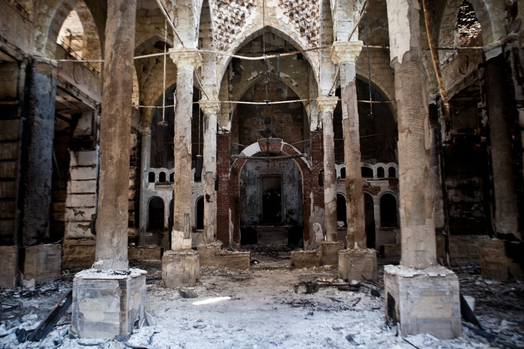A picture taken on August 18, 2013 shows the Amir Tadros coptic Church in Minya, some 250 kms south of Cairo, which was set ablaze on August 14, 2013. Egypt's Christians are living in fear after a string of attacks against churches, businesses and homes they say were carried out by angry supporters of ousted Islamist president Mohamed Morsi. As police dispersed Morsi supporters from two Cairo squares on August 14, attackers torched churches across the country in an apparent response. AFP PHOTO / VIRGINIE NGUYEN HOANG (Photo credit should read VIRGINIE NGUYEN HOANG/AFP/Getty Images)
