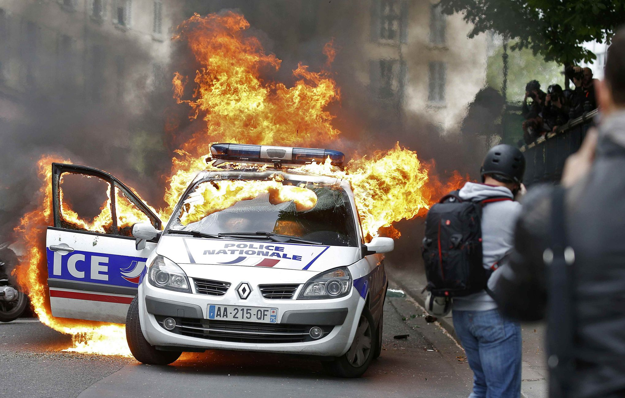A police car burns during a demonstration against police violence and against French labour law reform in Paris, France, May 18, 2016. REUTERS/Charles Platiau