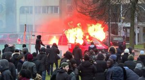 An image grab taken from an AFP video shows a van of French radio station RTL burning during clashes on the edge of a rally to denounce police brutality after a black man was allegedly sodomised with a baton during an arrest while in their custody in Paris on February 11, 2017 in Bobigny, outside Paris.<br /> A 22-year-old black youth worker named as Theo, a talented footballer with no criminal record, required surgery after his arrest on February 2, 2017 when he claims a police officer sodomized him with his baton. One officer has been charged with rape and three others with assault over the incident in the tough northeastern suburb of Aulnay-sous-Bois which has revived past controversies over alleged police brutality. / AFP PHOTO / Gregoire HOZAN
